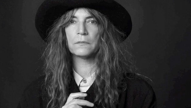 Patti Smith and her band performing Horses